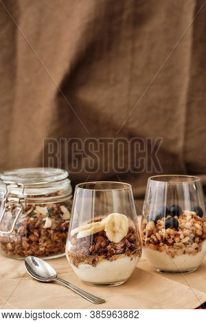 Close Up Of Delicious Layered Dessert In Glass Jar, Homemade Yogurt With Granola And Berries, Granol