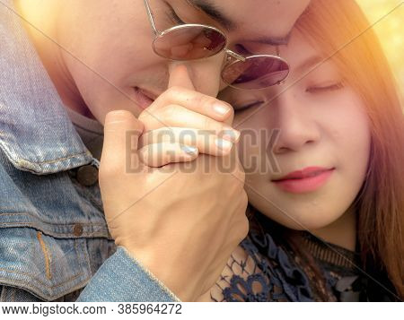 Close-up Portrait Of A Beautiful Young Kissing Couple, Sentimental Happy Couple In Love Bonding
