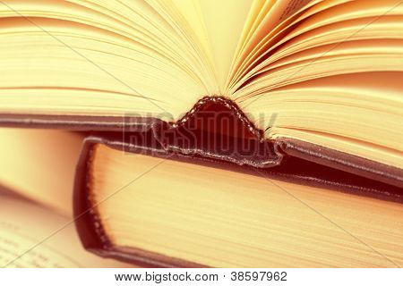 Closeup view of hardcover books. Toned