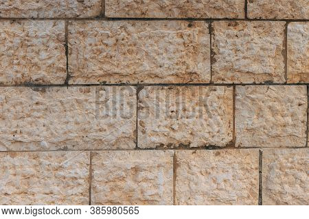 Jerusalem Stone Wall. Old Wall Made Of The Jerusalem Stone In Israel. Old Restored Wall. Fragment Of