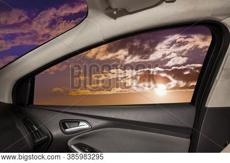 Heavenly Landscape Behind  Car  Door Window Photo