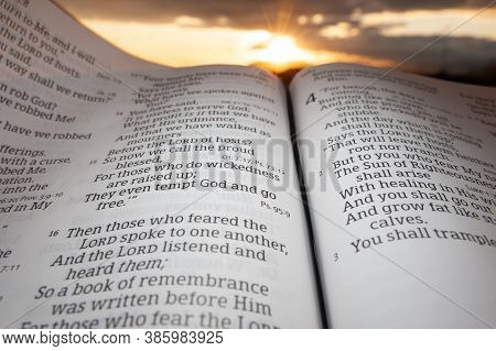 Fuji City, Shizuoka, Japan - February 2, 2020: Holy Bible Open At Sunset With Highlight On Malachi C
