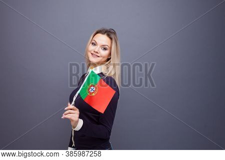 Immigration And The Study Of Foreign Languages, Concept. A Young Smiling Woman With A Portugal Flag