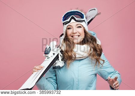 Cheerful Positive Young Female Skier Is Preparing To Ski. Woman In Equipment And With Skis, Winter S