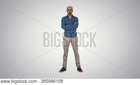 Serious Confident Arabian Man In Casual Folds Hands Looking Into