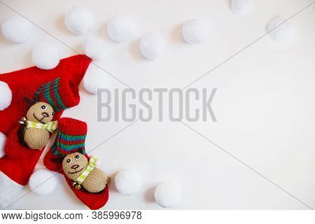 Santa Hat, Childish Socks With Animals And Lots Of White Balls On A White Background. Christmas Flat