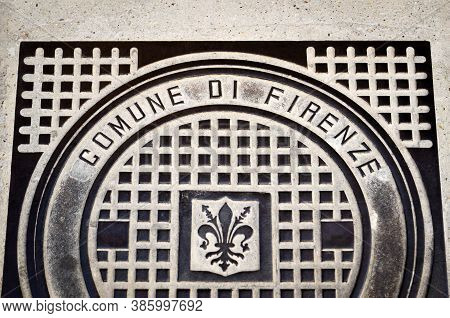 Florence, Italy - February 11, 2018: Ronund Manhole On The Roads Of Florence, Italy, With The City C