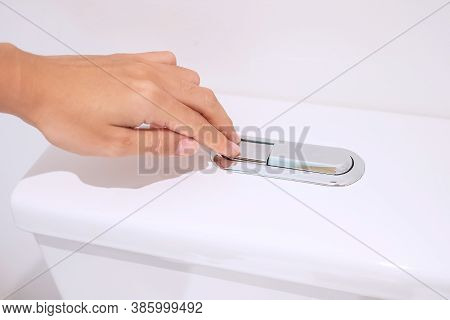 Hand Press And Flush Toilet Bowl. Cleaning, Lifestyle And Personal Hygiene Concept