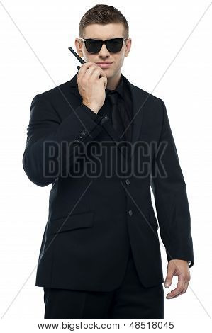 Half Length Portrait Of Young Sincere Security Officer