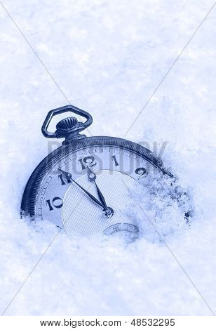 Pocket watch in snow Happy New Year greeting card