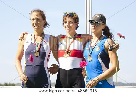 MONTEMOR-O-VELHO, PORTUGAL 11/09/2010. TAUPE-TRAER Michaela (AUT) (l) 2nd place, DRAEGER Marie-Louise (GER) (c) winner, and MILANI Laura (ITA) (r) 3rd, in the Women's lightweight Single Sculls