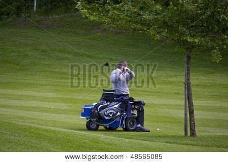 SAINT-OMER, FRANCE. 16-06-2010, A disabled golfer on a specially adapted cart the European Tour, 14th Open de Saint-Omer part of the Race to Dubai tournament and played at the AA Saint-Omer Golf Club