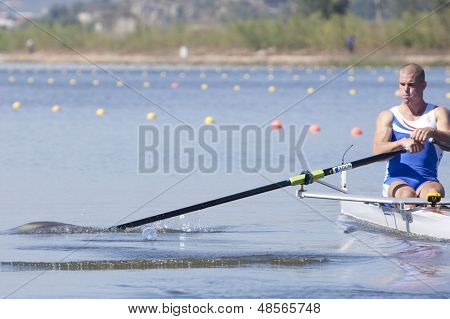 MONTEMOR-O-VELHO, PORTUGAL 10/09/2010. BRAAS Roel (NED) hits a discarded water bottle whilst competing in the Men's Single Sculls at  the 2010 European Rowing Championships held at the aquatic centre