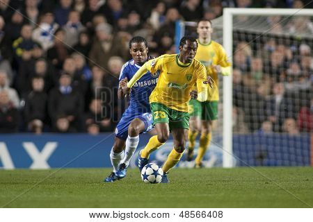 LONDON ENGLAND 23-11-2010.Chelsea's midfielder Florent Malouda and MSK Zilina's forward Bello  in action during the UEFA Champions League group stage match between Chelsea FC and MSK Zilina