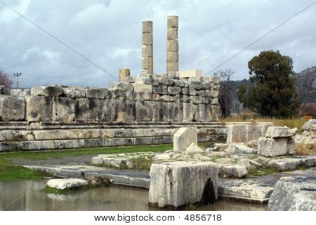 Water and ruins of old temple in Letoon Turkey poster