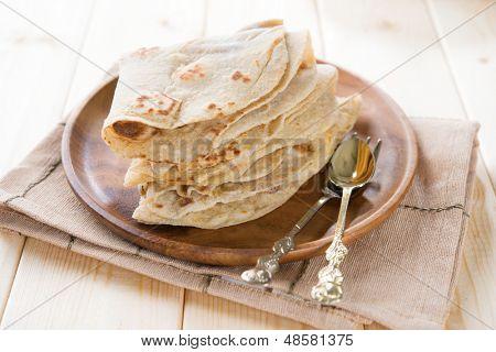 India vegetarian food plain chapatti roti or Flat bread. Indian food on dining table.