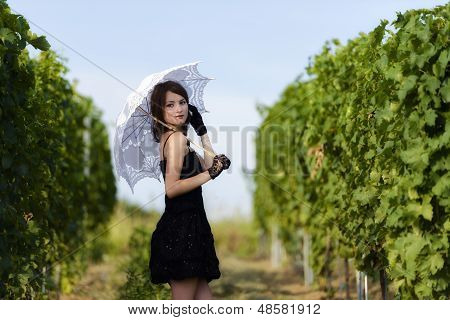 Elegant Young Woman Outdoor Portrait Lean On Wall Covered In Vines