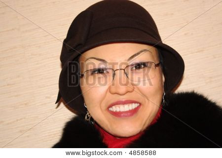 The Woman In A Hat And Glasses