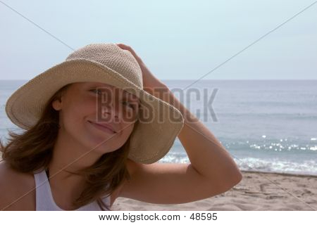 Girl Holding Her Hat On