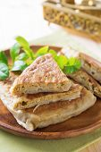 Malaysia muslim food Martabak or murtabak on dining table. poster