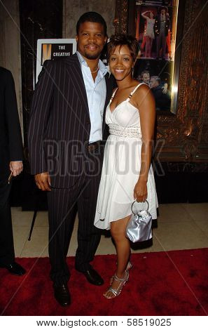 HOLLYWOOD - AUGUST 15: Sharif Atkins and Chrystee Pharris at the Los Angeles Premiere of Dirty Rotten Scoundrels on August 15, 2006 at Pantages Theatre in Hollywood, CA.