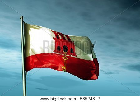 Gibraltar flag waving in the evening