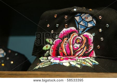 LOS ANGELES - AUGUST 15: Close-up of a decorated baseball cap at the Christian Audigier New Collection Launch Party in Babe Le Strange on Melrose on August 15, 2006 in Los Angeles, CA.
