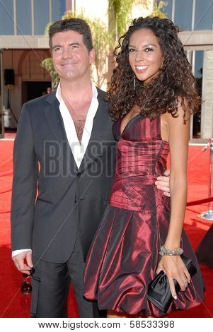 LOS ANGELES - AUGUST 27: Simon Cowell and Terri Seymour arriving at the 58th Annual Primetime Emmy Awards at The Shrine Auditorium on August 27, 2006 in Los Angeles, CA.