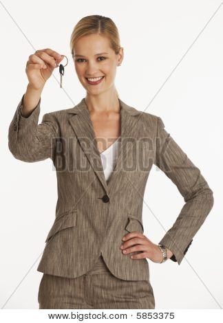 Businesswoman Holding Up Keys