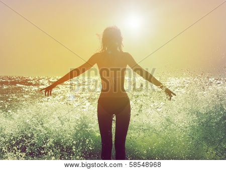 Beautiful Woman in the Sea Waves Rear View