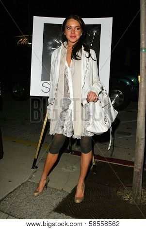 HOLLYWOOD - APRIL 05: Lindsay Lohan at the opening of Sienna Boutique at Sienna on April 05, 2006 in Los Angeles, CA.