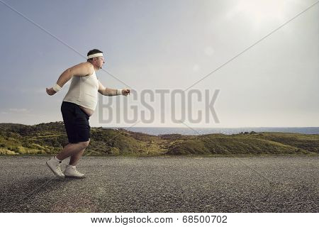 Funny Overweight Man Jogging On The Road