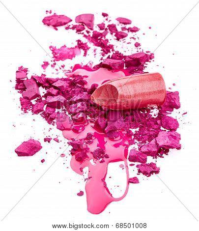 Crushed eye shadow nail polish and lipstick isolated on white backgrund poster