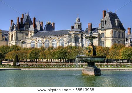 Beautiful Park with pond of ancient Fontainebleau palace. Palace of Fontainebleau - one of the largest Medieval royal chateaux in France (55 km from Paris)