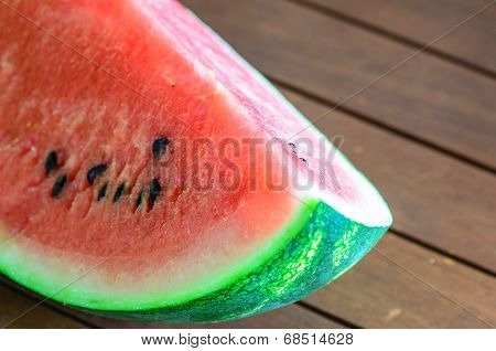 Closeup Of Sliced Watermelon On Wooden Table