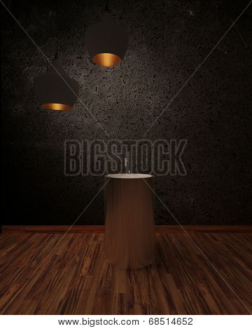 Wash basin in a shadowy interior under two illuminated hanging lamps