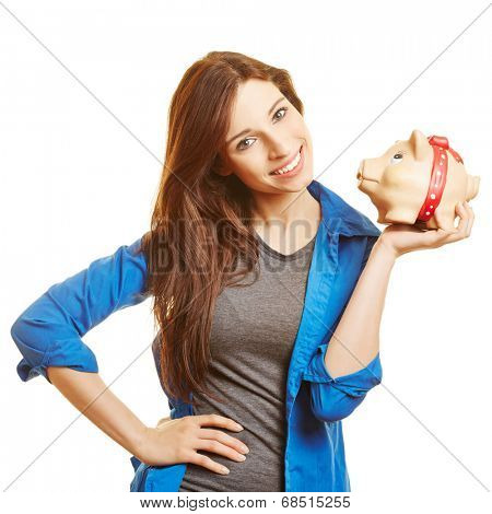 Smiling young woman holding piggy bank on her hand