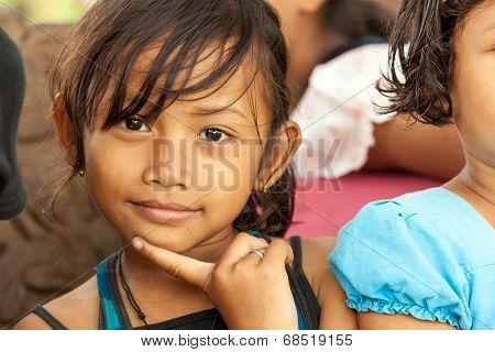 BUKIT LAWANG, INDONESIA, JULY 07, 2010: Unidentified little girl posing among her friends in the Bukit Lawang village, Sumatra, Indonesia.