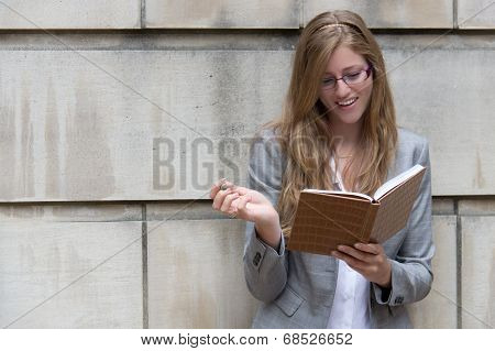 Beautiful, Smiling Woman Writing In Her Journal