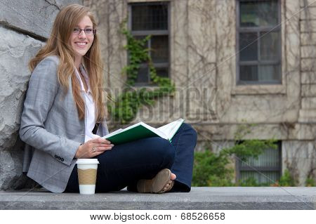 University Student Studying Outside On Campus
