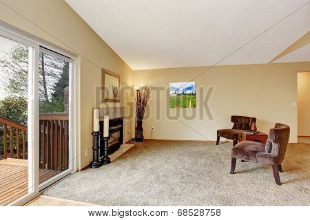 Empty Living Room In Soft Ivory With Fireplace And Walkout Deck