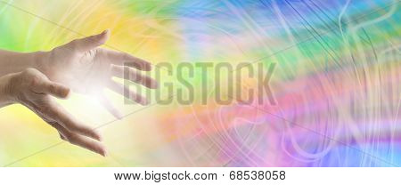 Healing hands outstretched with a swirling rainbow energy background poster