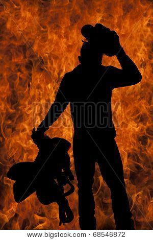 a silhouette of a cowboy with a fire background holding on to his hat and saddle. poster