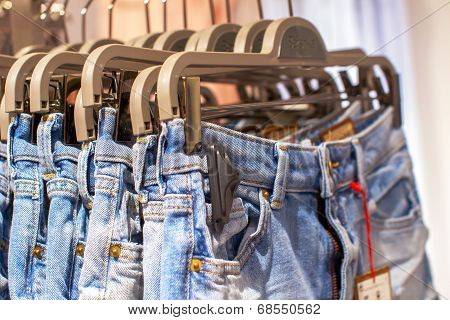 Preview Jeans Hanging On A Hanger In The Store