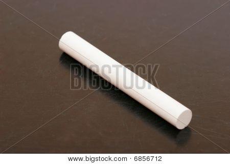 Stick Of Chalk On Blackboard