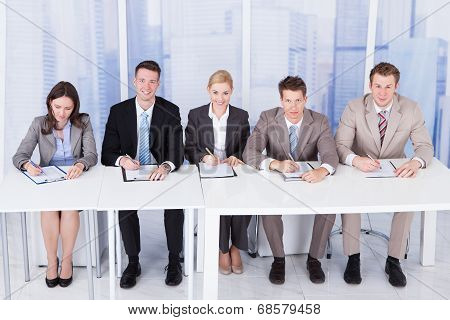 Corporate Personnel Officers Sitting At Table