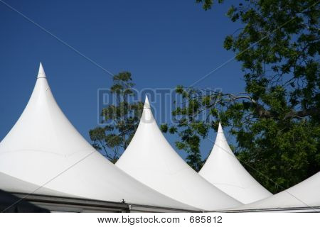 White Tent roof against a bright blue sky poster