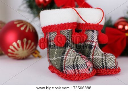 Christmas shoes on mantelpiece on white wall background