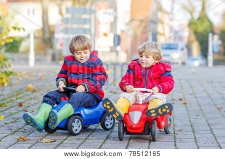 Two Happy Friends Boys Playing With Colorful Toy Car, Outdoors