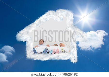 Family wearing stripey socks against bright blue sky with clouds